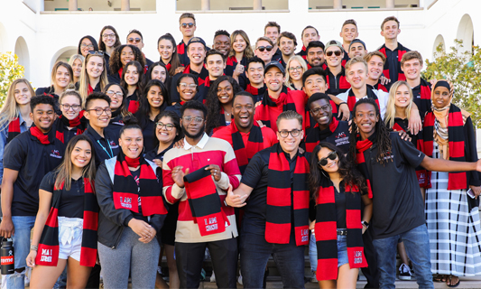 Group of students in I AM SDSU scarves