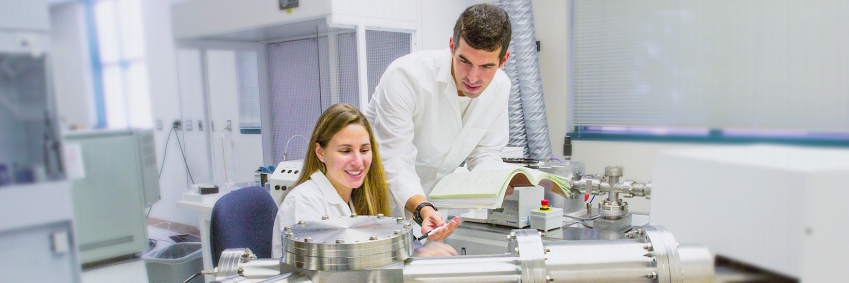 A student and professor working in a lab